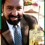 Business man smiling holding drink