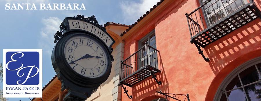 'Old Town' clock next to orange building outside in Santa Barbara