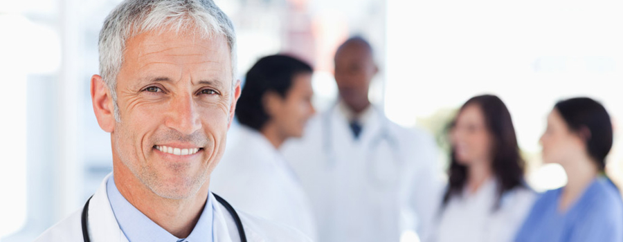doctor smiling with doctors in background