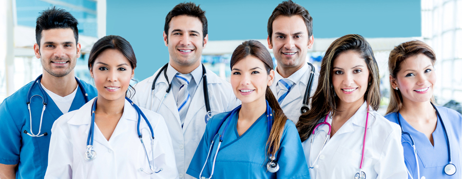 Doctors and nurses standing smiling