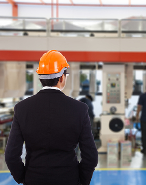 Business man in hard hat overseeing workers