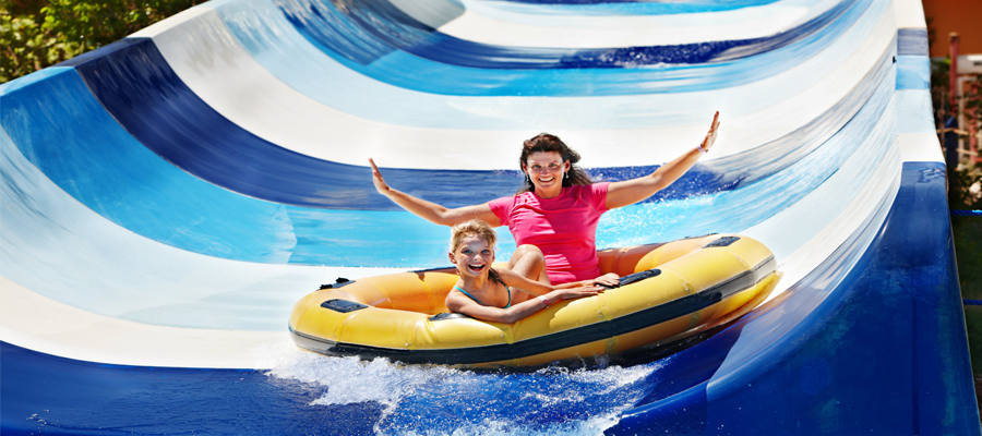 Woman and kid in raft at waterpark