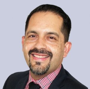 David Rodriguez smiling in suite and tie