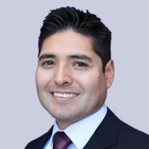 Marvin Uzqueda smiling in suite and tie