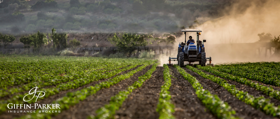 tractor spraying field for pesticides
